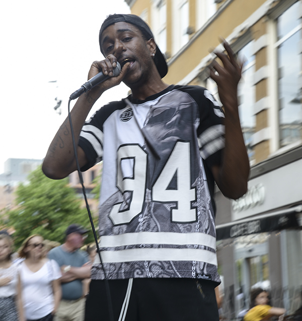 Rapper King Shway performs outside Cafe Sor as a crowd watches. He is an American musician living in Norway, focused on growing and developing his musical career. Photo by Billy Ray Malone
