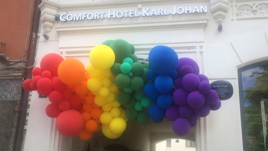 Balloon display on a Comfort Inn hotel overlooking Oslo Pridefest. Photo by Stacie Chandler